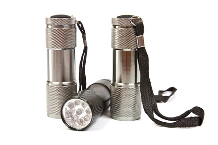 LED flashlights with aluminum body and hand strap on a white background photo