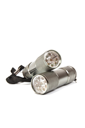 torchlight: LED flashlights with aluminum body and hand strap on a white background