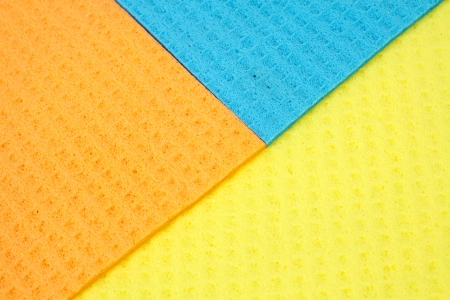 Kitchen towels porous absorbent material in yellow, orange and blue photo