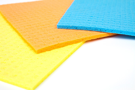 porous: Kitchen towels porous absorbent material in yellow, orange and blue Stock Photo