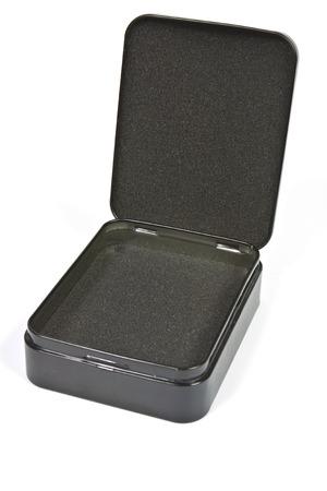 Empty open black metal box close-up photo