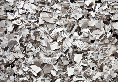 Broken into small pieces of newsprint recycling photo