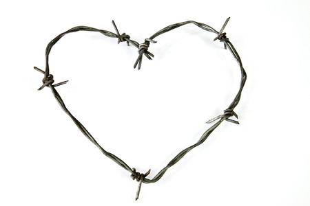 gaol: Wire bent in the shape of a heart on a white background Stock Photo