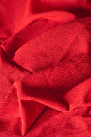 Red cloth with wrinkles on plane photo