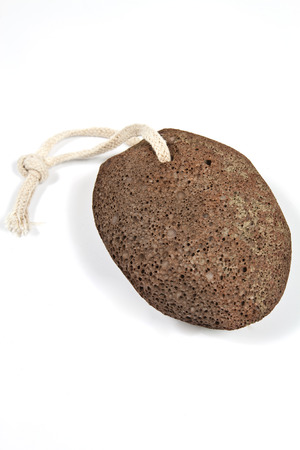 Shaped piece of brown natural pumice stone to use in personal hygiene