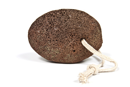 vesicular stone: Shaped piece of brown natural pumice stone to use in personal hygiene