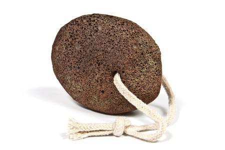 scoria: Shaped piece of brown natural pumice stone to use in personal hygiene