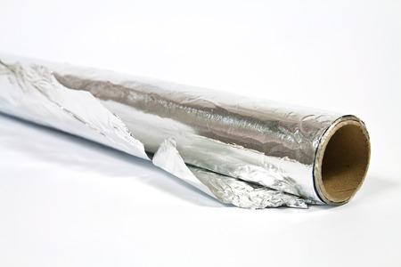 Roll of household aluminum foil on white background