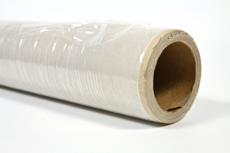 Roll of stretch film with different functions on a white background