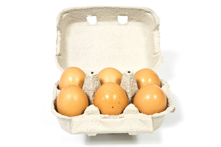 Six eggs from home  happy hens  in a box made ??of recycled paper photo