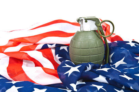 Military hand grenade on American flag