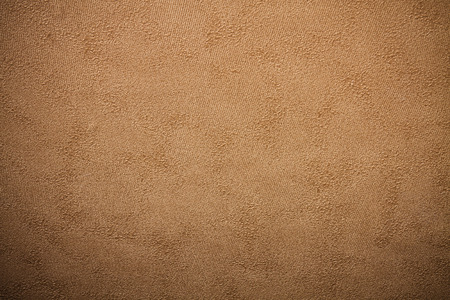 designed: Embossed paper wallpaper in brown tone with vignetting corners