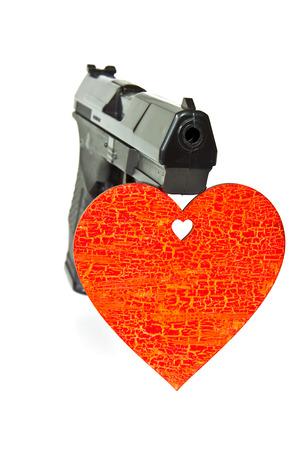 pneumatic: Pneumatic air gun and painted red wooden heart