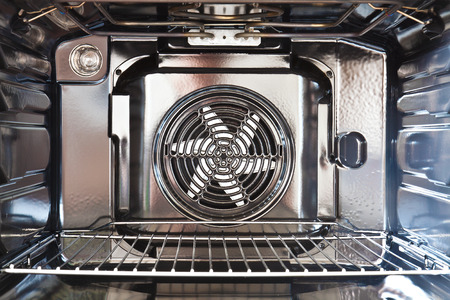 Detail of the interior of a modern oven built with fan Фото со стока