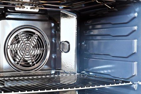 built: Detail of the interior of a modern oven built with fan Stock Photo