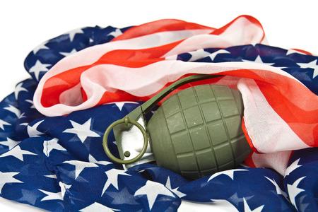 firepower: Military hand grenade on American flag