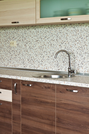 emphasis: Detail of kitchen furniture with an emphasis on contemporary ceramic mixer cusine