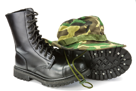 Camouflage hat and boots military equipment of the Armed Forces