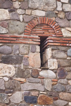 fortified wall: Detail of the exterior fortified medieval stone wall Stock Photo