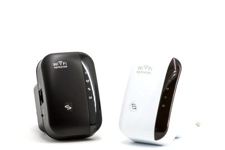 Wireless WiFi Repeater for your home network on a white background Stock Photo
