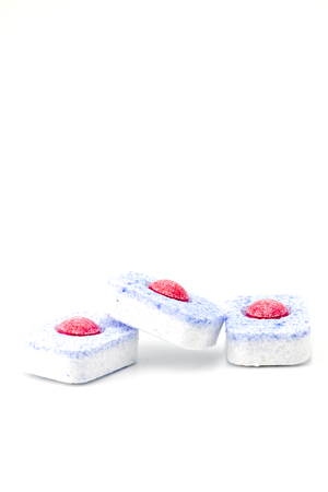 Group of three dishwasher tablets on a white background