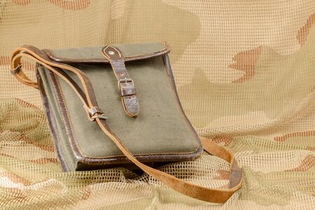 Old vintage canvas bag with leather strap Imagens
