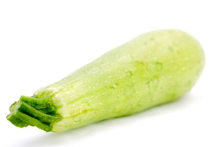Green zucchini on a white background.Selective focus with shallow depth of field