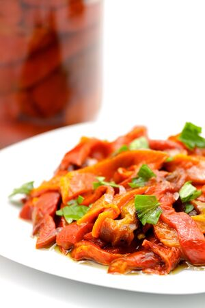 Sliced pickled red peppers sprinkled with fresh parsley.Selective focus with shallow depth of field. 版權商用圖片