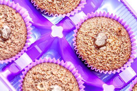 Chocolate muffins in a purple paper basket. Selective focus with shallow depth of field.