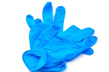 Pair of safety blue latex gloves for hygiene purposes. Selective focus with shallow depth of field.