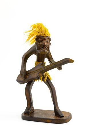 A wooden figure of a guitarist with hair and a hemp belt