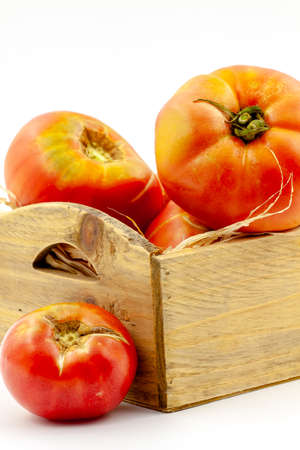Tasted freshly picked variety of pink tomato. Selective focus with shallow depth of field. Reklamní fotografie