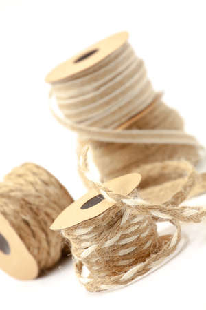 Rolls of braided cord of sackcloth and hemp for decoration and decoration. Selective focus with shallow depth of field.