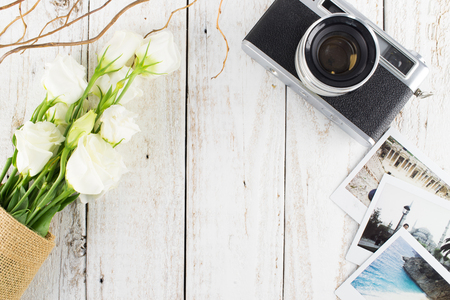retro flowers: Vintage Camera, Instax Photos and White Bouquet on White Wooden Background, Flat Lay Style with Free Text Space