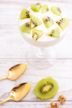 parfait: Homemade Kiwi Yoghurt Parfait with Granola Stock Photo