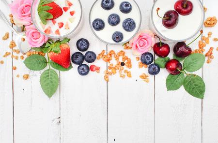 parfait: Homemade Blueberries, Strawberries, Cherry Yoghurt Parfait with Granola
