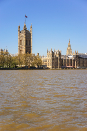 The Palace of Westminster over The Thames River with Clear Blue Sky
