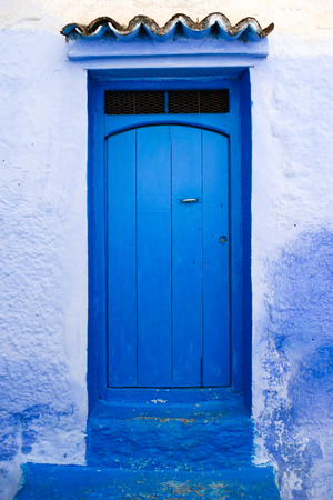 Traditional and Beautiful Blue Door,Old Medina, Chefchaouen, Blue City of northwest Morocco Standard-Bild - 101146640