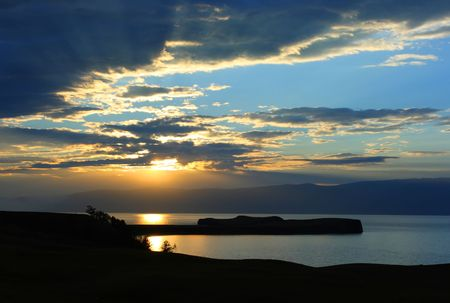 Beautiful sunset. Baikal lake. Blue mountains photo