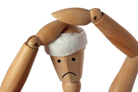banging: Isolated wood mannequin with headache pain hands