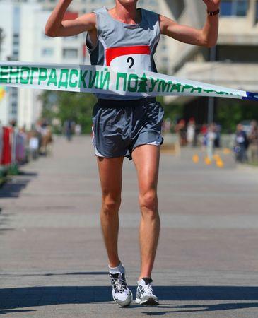 Finishing run man at the marathon competition photo