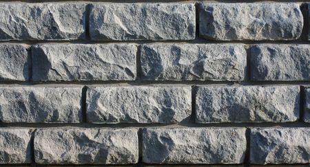 textured wall: Gray old brick textured wall. Cracked bricks.