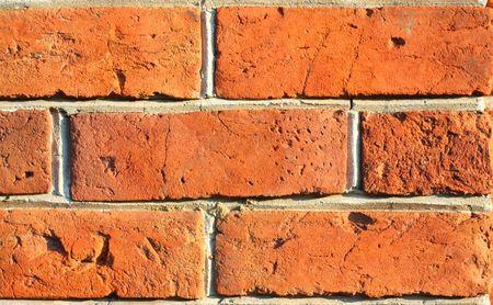 Red old brick textured wall. Cracked bricks. photo