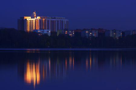 Night building near the water. Building crane. Stock Photo - 3648191