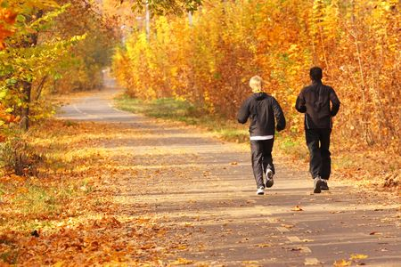 Two young boys run in the park. photo