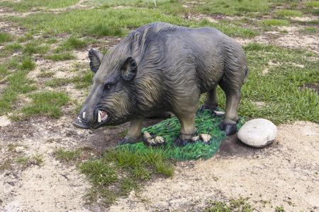 figurine of a wild boar in park Stock Photo