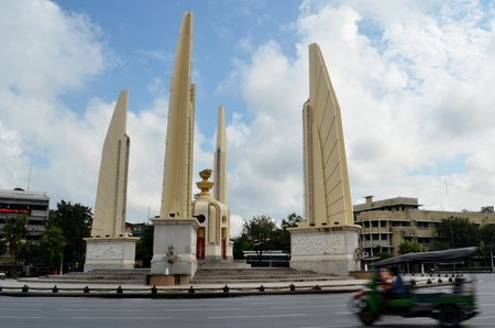 democracy monument and took took photo