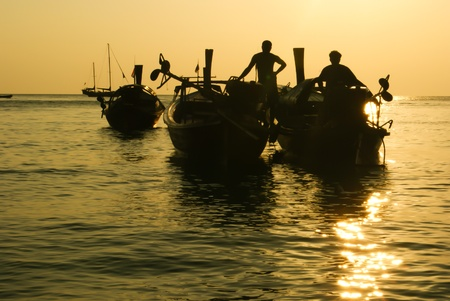 fishing boat and fishermen in Thailand photo