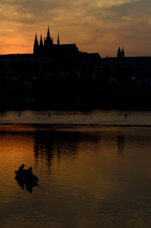 castle district: castle district in Prague and fishing boat