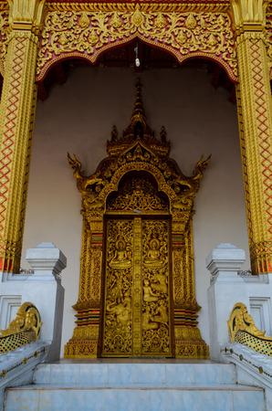 lao: golden door of buddhist temple in Luang Prabang Lao
